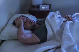 Man having difficulty calming anxiety at night